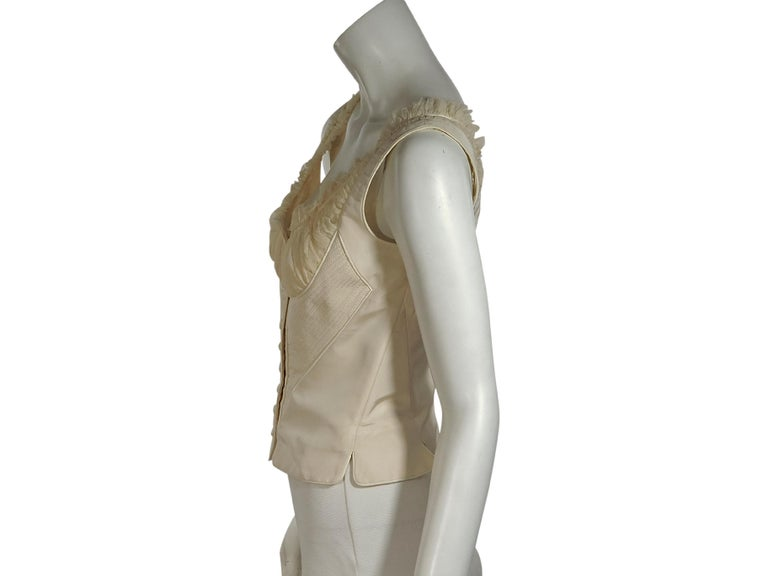 Product details:  White silk corset top by Alexander McQueen.  Scoopneck.  Sleeveless.  Button-front closure.  Lace-up back detail.  32