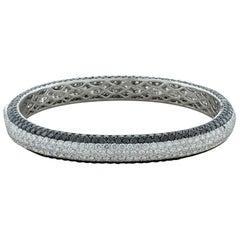 White and Black Diamond Pavé Gold Eternity Bracelet