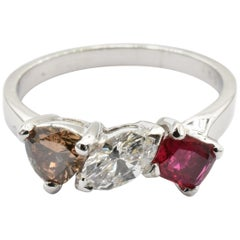 White and Champagne Diamonds and Ruby Three-Stone Ring Made in Italy
