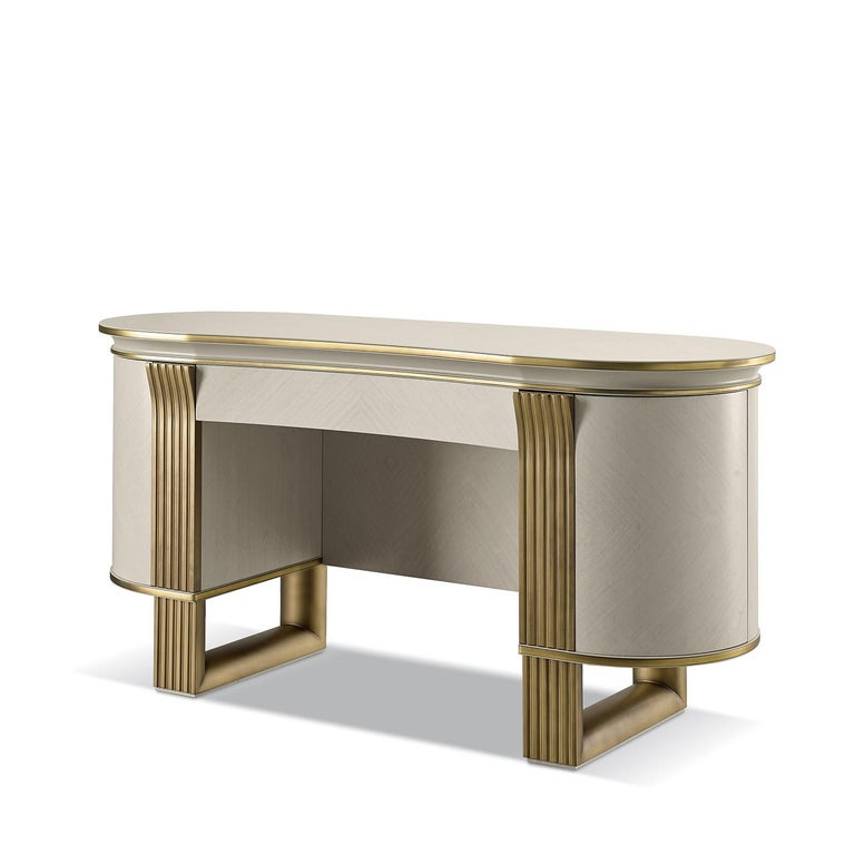 This vanity will be a unique addition to both a classic or midcentury-inspired bedrooms. Exuding elegant and refined allure, the oval-shaped silhouette is crafted of plywood and white eucalyptus-veneered MDF marked with a golden-finished metal