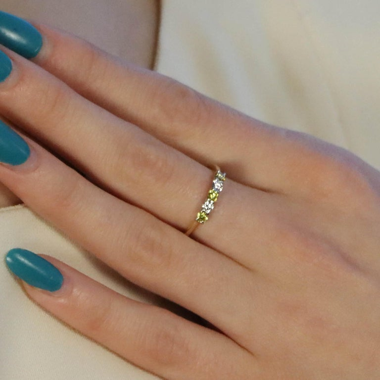 Modern White and Natural Yellow Diamond Half Eternity Ring Set in 18 Karat Yellow Gold For Sale