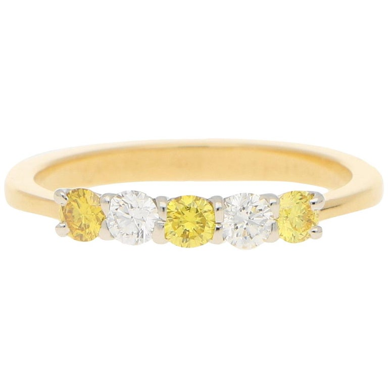White and Natural Yellow Diamond Half Eternity Ring Set in 18 Karat Yellow Gold For Sale