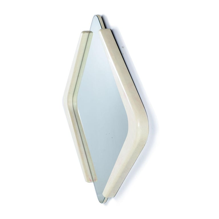 This diamond shaped white lacquer mirror was designed by Karen Cooper for Finish Design. This Memphis style faux marble mirror commands attention. The white lacquer has faint pink blushes and veins mimicking the effect of Fine Italian Marble. We