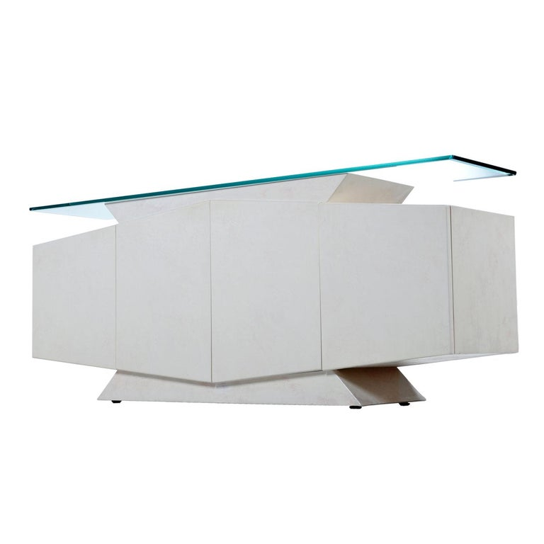 We're certain you've never seen anything quite like this and neither have we. Art Deco inspired pedestals on both the top and bottom set the tone for this Postmodern, geometric monumental masterpiece. This white lacquer credenza was designed by