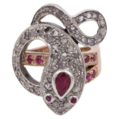 White and Yellow Gold, Ruby and Rose Cut Diamond Snake Ring