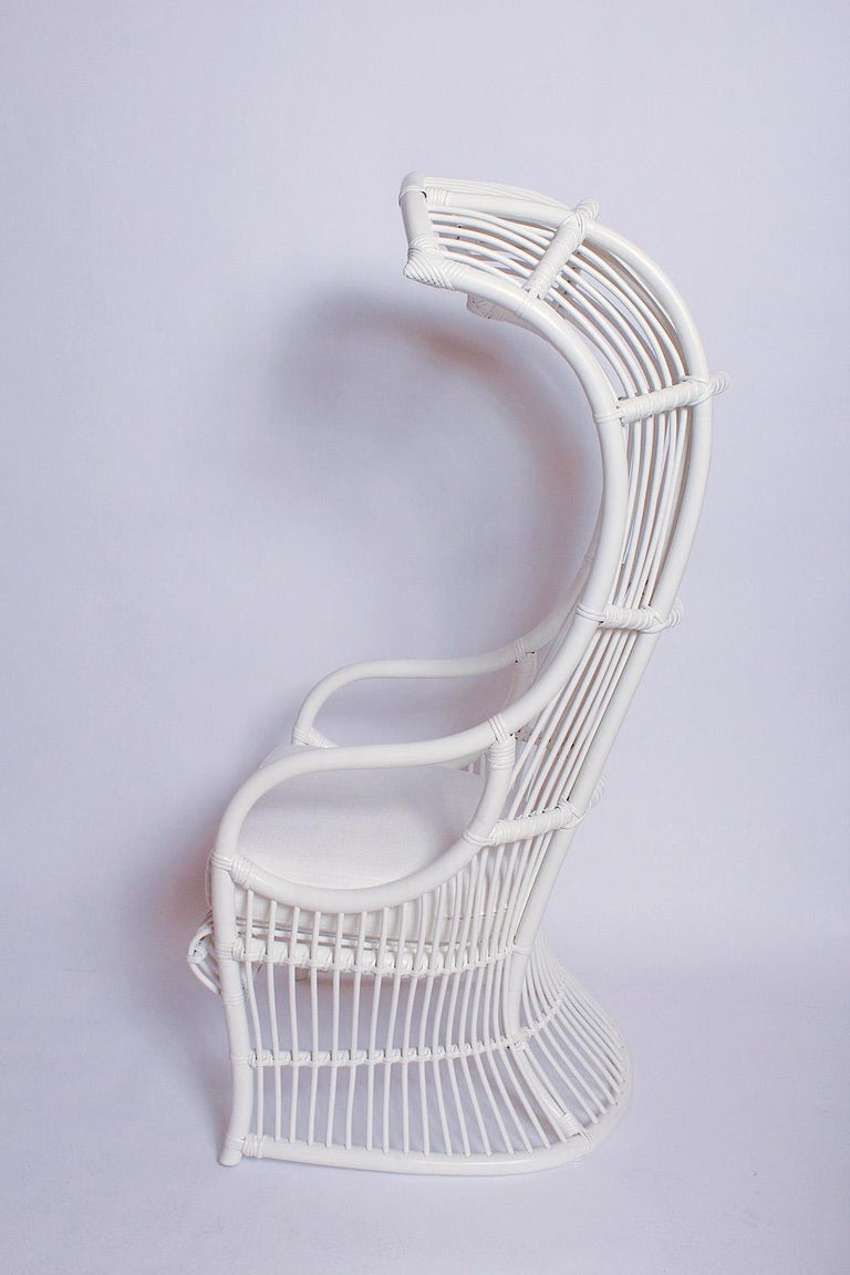 This relaxation-ready iconic bamboo and rattan canopy chair by Henry Olko for Willow and Reed has a fresh coat of white paint and new seat cushion.