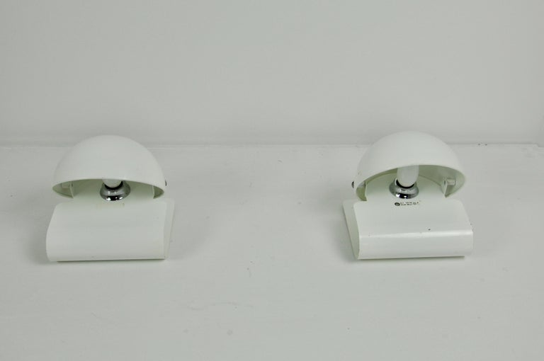 Pair of metal lamp in white color. Slight wear due to time and the age of the object.