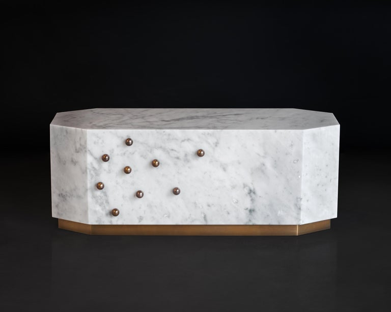 Coffee table made of a solid block of white Carrara marble from the finest quarries, with decorative small spheres and hand-welded base in light bronze finish brass. Made in our atelier in Florence, Italy. Base and spheres available in different