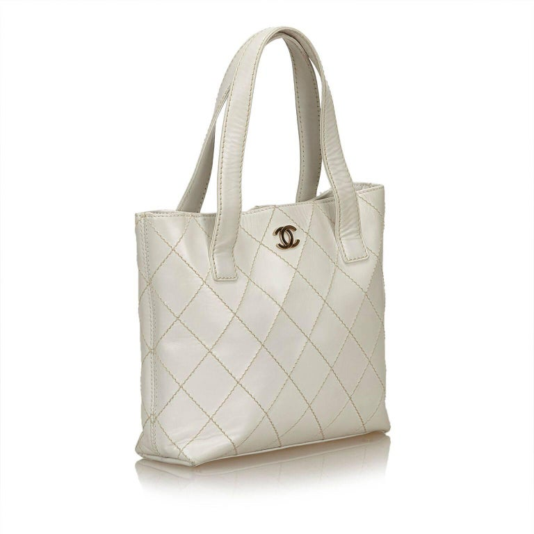 5a0331317422 Product details: White leather Surpique tote bag by Chanel. Quilted  topstitched design. Dual
