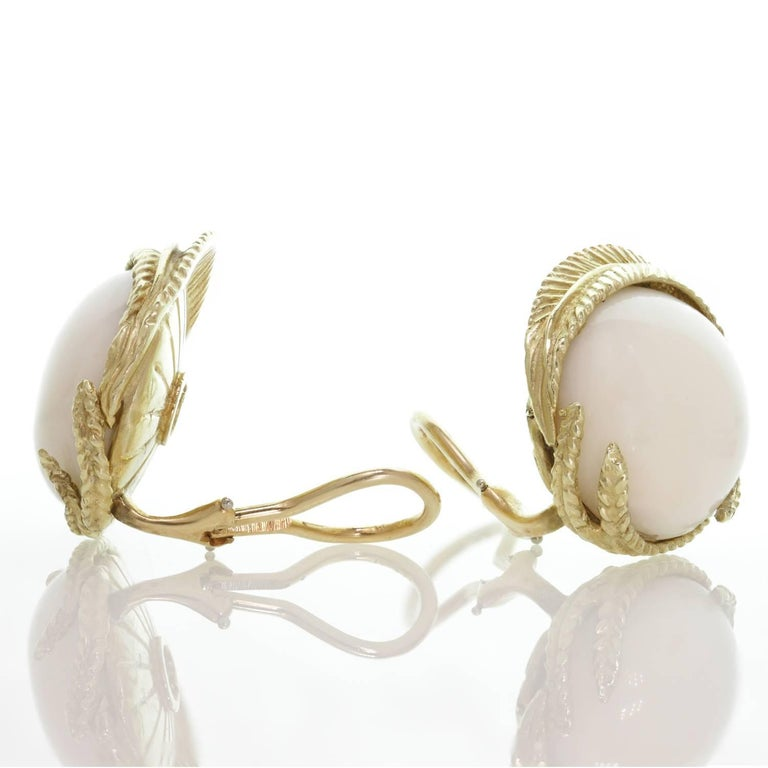 These fabulous clip-on earrings feature 17.0mm round natural white corals set in yellow gold. Circa 1960s. Measurements: 0.94