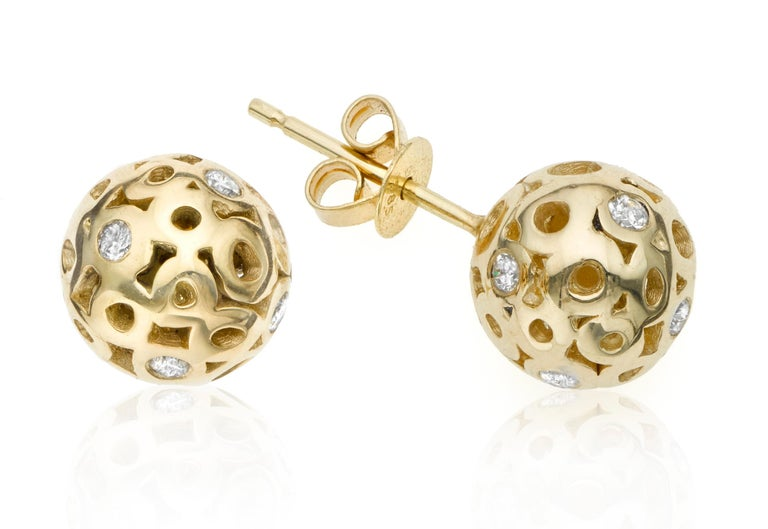 This is not your ordinary classic stud earring.  Made of two half-spheres composed of Hi June Parker's signature organic circles sprinkled with white diamonds. Also a sophisticated and elegant option for bridal or weddings.  Inspired by seeing the