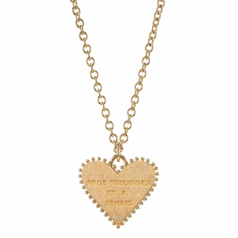 This lovely 14 karat yellow gold two sided Marlo Laz heart charm coin reads on its back