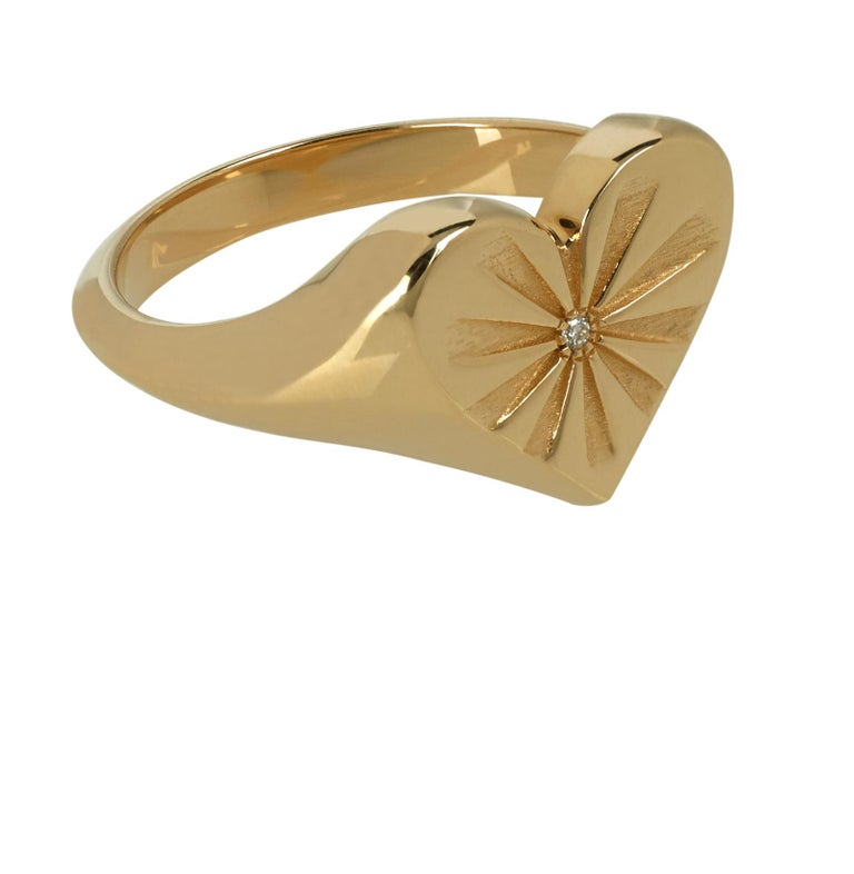 Marlo Laz's twist on a traditional signet, this heart of gold signet ring is an instant heirloom. This romantic valentine 14 karat love ring features a white diamond and sun-rays of sunshine. Perfect for Valentine's Day!  This ring is available in