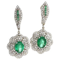 White Diamond and Emerald Drop Earrings in 18 Karat White Gold