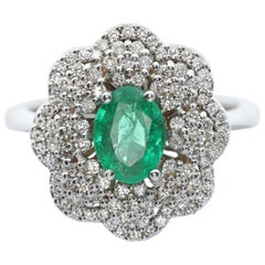 White Diamond and Emerald Flower-Shaped Cocktail Ring
