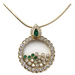 White Diamond and Emerald Movement Necklace in 18 Karat Yellow Gold