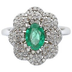 White Diamond and Emerald Ring in 18 Karat Gold