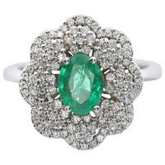 White Diamond and Emerald Ring in 18 Karat White Gold