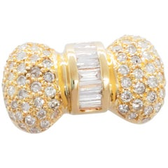 White Diamond Baguette and Round Bow Design Ring in 18 Karat Yellow Gold