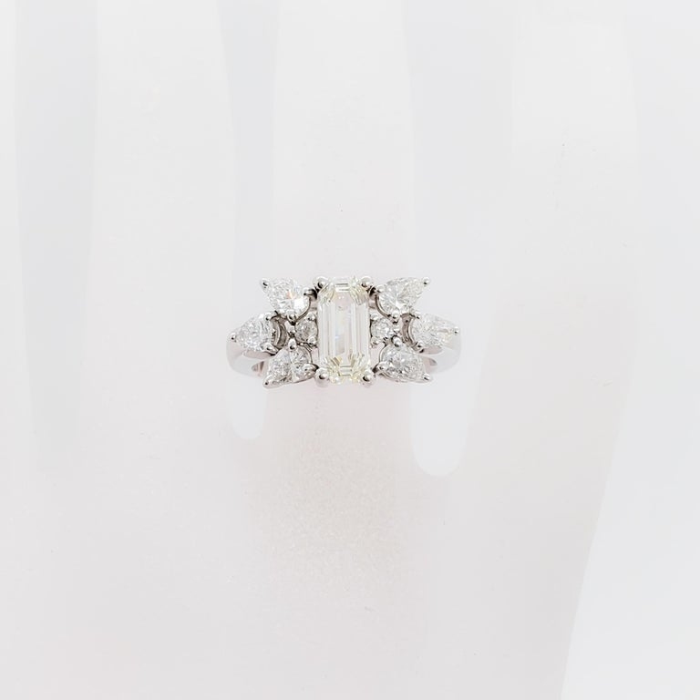 Beautiful estate 1.06 ct. white diamond emerald cut with 1.07 ct. of white diamond pears and rounds.  Handmade mounting in platinum.  Ring size 6.5.  Good quality, white, and bright diamonds.  Excellent condition.