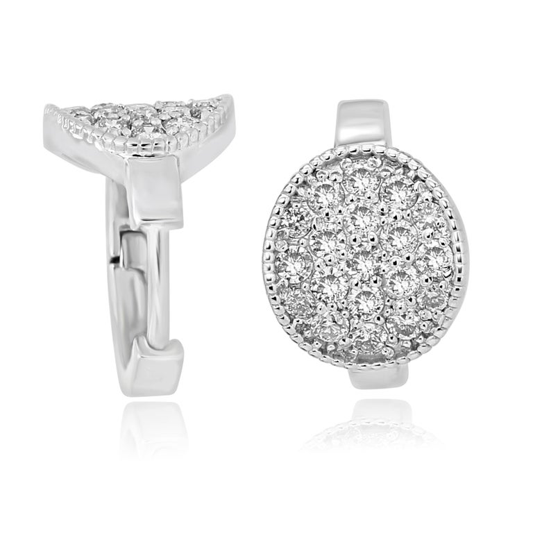 Stunning every day wear 14K White Gold Clip on Earring with White Diamond Round 0.64 Carat with Filigree on the side.  MADE IN USA