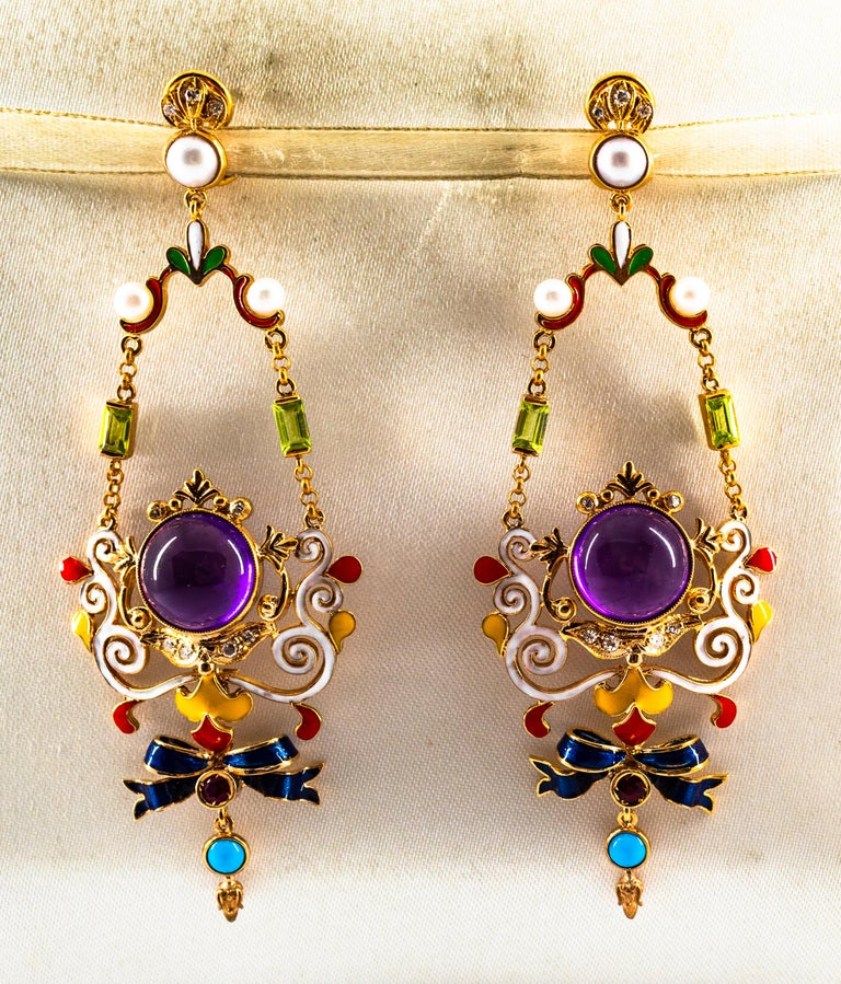 These Earrings are made of 9K Yellow Gold. These Earrings have  0.30 Carats of White Modern Round Cut Diamonds. These Earrings have 0.20 Carats of Rubies. These Earrings have 0.40 Carats of Peridots. These Earrings have Amethyst and Turquoise. These