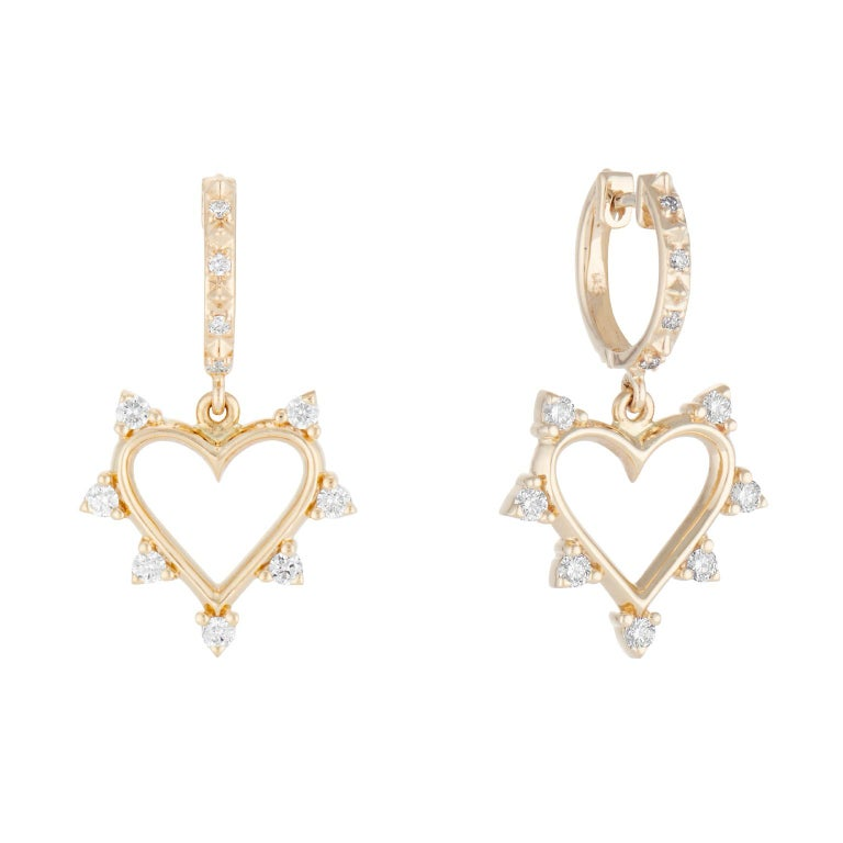 These Marlo Laz Open Heart Hoop Earrings serve as a reminder to approach everything with an open heart, open soul, and open mind. These romantic 14 Karat yellow gold love earrings feature a spiked border of white diamonds and Pave diamond hoops that