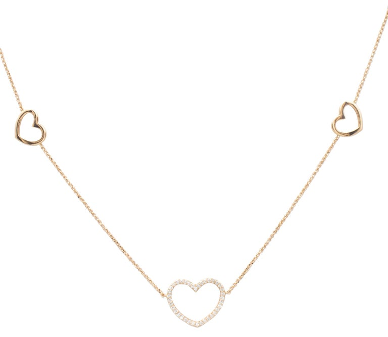 Lovely chain necklace realized in 18kt rose gold structure and composed of 9 rose gold hearts; 8 small heart and one big (6 are simple only in 18kt rose gold and 3 are studded by 0.85 ct of white little diamonds; the three studded by diamonds are 2