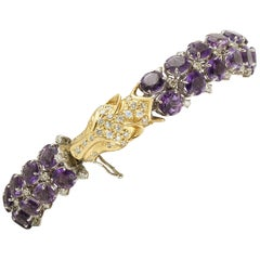 White Diamonds Amethysts 18 Karat Yellow and White Gold Wolf Head Link Bracelet