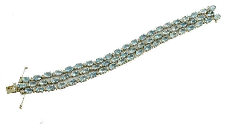 Three tennis that make an unusual bracelet in 14K white gold studded by white diamonds and aquamarines Diamonds 1.48 ct  Aquamarines 23.8 ct  Total Weight 24.20 ct  R.F ++ iifi Length 18 cm