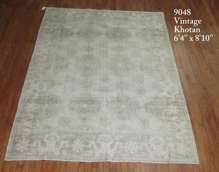 A mid-20th century weather textured or distressed East Turkestan Khotan rug.