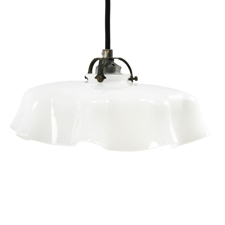 Dutch opaline glass industrial pendant. Excluding light bulb.  Weight 1.50 kg / 3.3 lb  All lamps have been made suitable by international standards for incandescent light bulbs, energy-efficient and LED bulbs. E26/E27 bulb holders and new