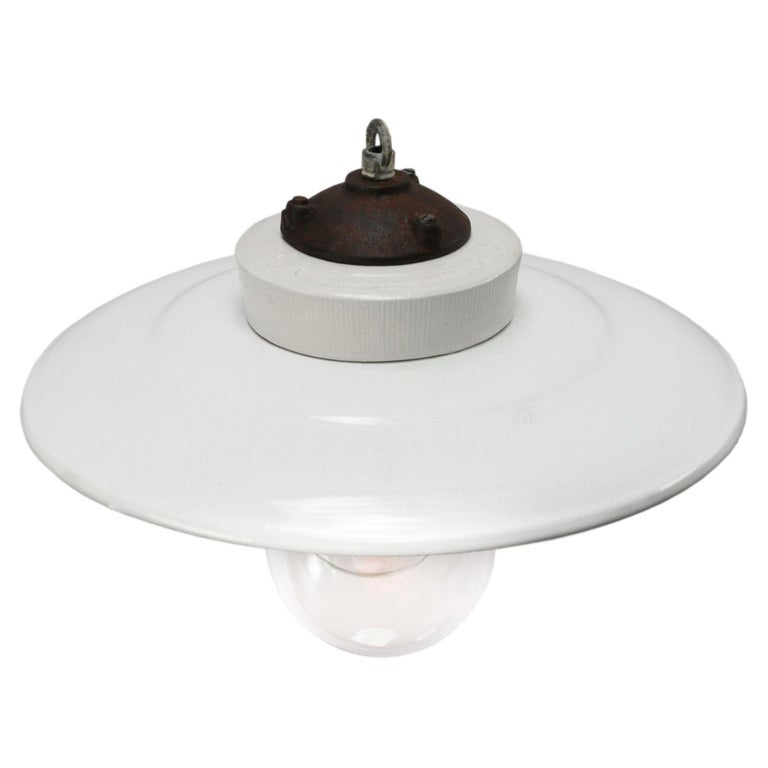 Porcelain industrial hanging lamp. White porcelain, cast iron and clear glass. White enamel shade 2 conductors, no ground.  Weight: 1.70 kg / 3.7 lb  Priced per individual item. All lamps have been made suitable by international standards for