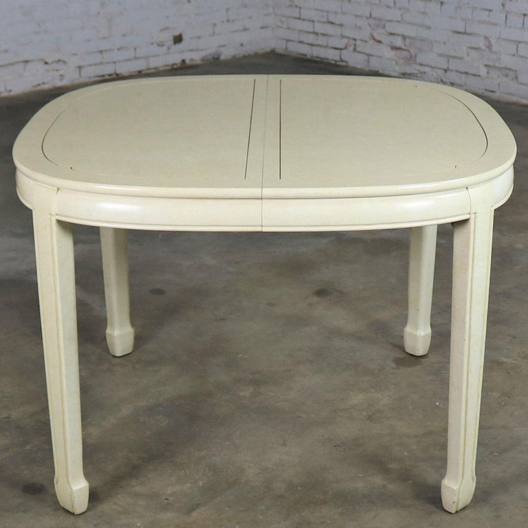 Handsome off-white Asian style, Ming style, or Chinoiserie oval dining table with two leaves by White Fine Furniture. It is in wonderful vintage condition. There are a few nicks and dings as you would expect for its age but nothing outstanding. We