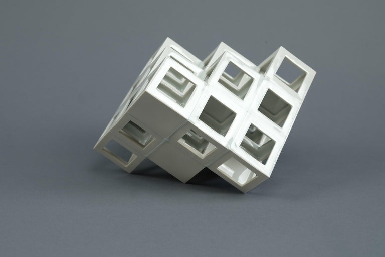 """""""Lattice receptacle"""" series is a work of art made out of porcelain lattice structure as a fundamental form. Its creation is constructed by the accumulation of the base unit (cubic hollow) that is formed regularly by slip casting technique. For his"""
