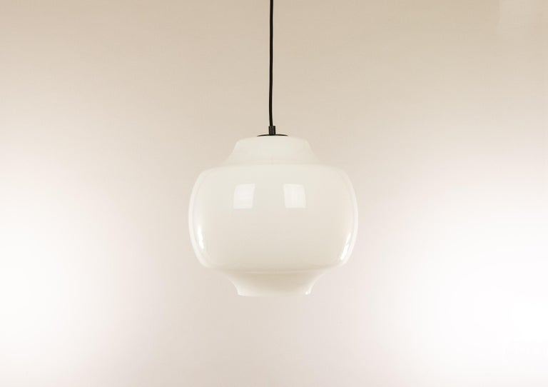 White Murano glass pendant by Alessandro Pianon for Venetian glassmaker Vistosi, designed in the 1960s.  The lamp wasproduced in three different colors: grey, yellow and white. The glass is subtleandstill in beautiful vintage condition. The top
