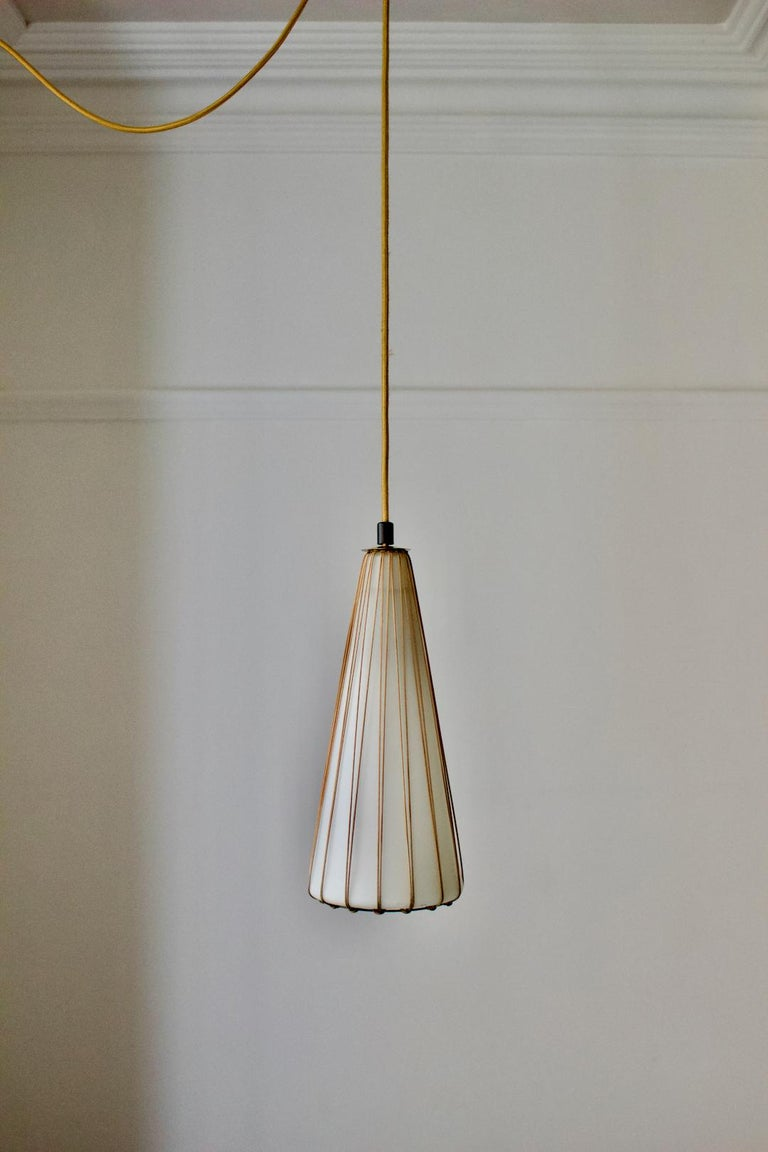 White satin glass pendant light with rattan detail and brass canopy. Made by Idman Oy, Finland 1950s.  A simple elegant design, nicely made, combining the lightness of the glass with the substantial brass canopy. This design appears in the Idman