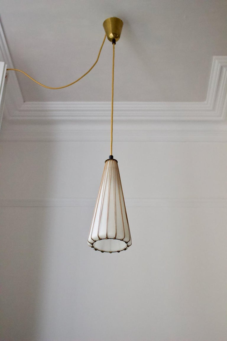 Mid-Century Modern White Glass Pendant Light with Rattan & Brass Details by Idman Oy, Finland