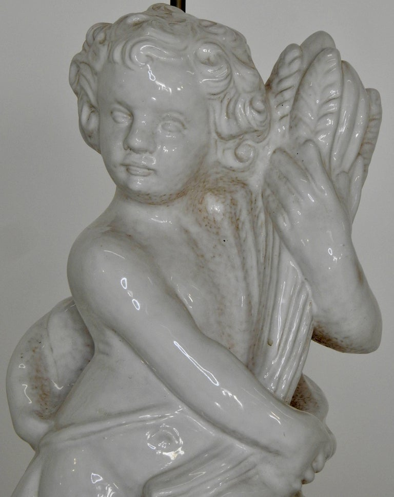 Italian White Glazed Terracotta Cherub Lamps on Wooden Bases, Pair For Sale
