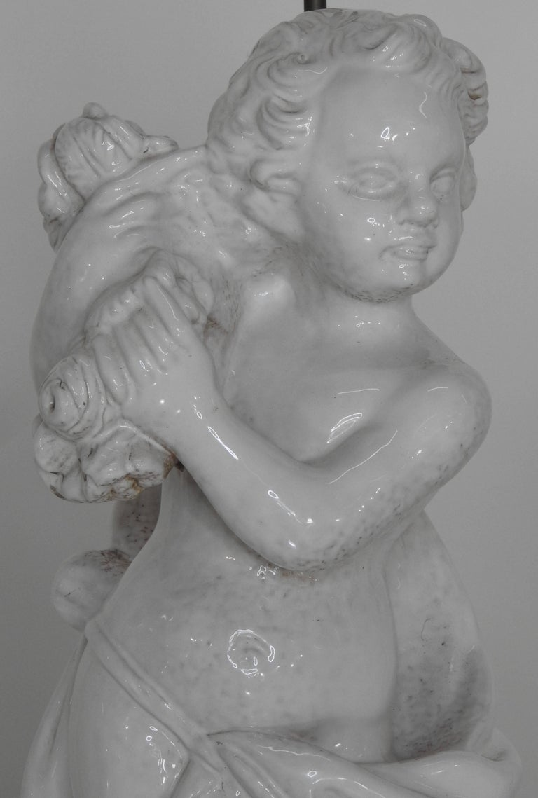 White Glazed Terracotta Cherub Lamps on Wooden Bases, Pair In Fair Condition For Sale In Cookeville, TN