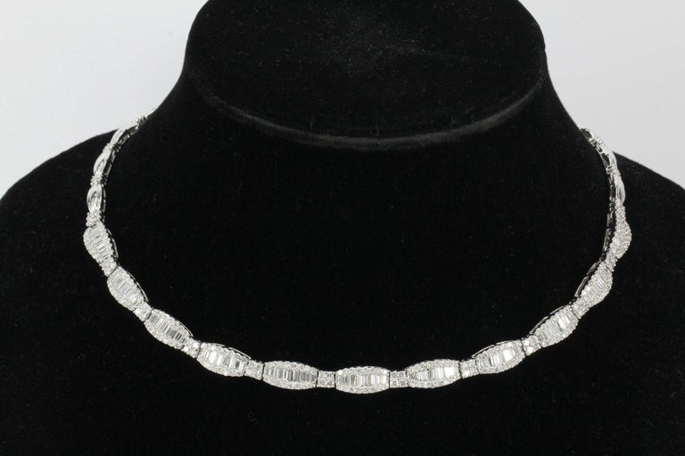 Era: Modern  Hallmarks: 14K  Composition: 14K White Gold  Primary Stone: Diamonds   Shape: Baguettes and Rounds  Color/Clarity: G/H - Baguettes VS1/2, Rounds SI1/2  Total Diamond Weight: Approximately 10 carats  Total length: 17 inches  Necklace