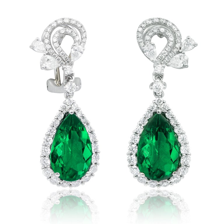 18KT white gold fashion drop earrings features 2.28 cts of white round and pear shaped diamonds and 8.73 cts of pear shaped emeralds.  This product will be packaged in a custom box  Composition: 18K white gold 2.28 ct round and pear shaped
