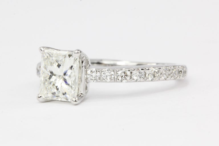 Era: Modern  Hallmarks: 14K  Composition: 14K White Gold  Primary Stone: Diamond  Stone Carat: Approximately 1.11 carats  Color / Clarity: G / VS1  Shape: Princess Cut  Accent Stone: Diamonds  Color/Clarity: H/I - VS2/SI1  Total Diamond Weight: