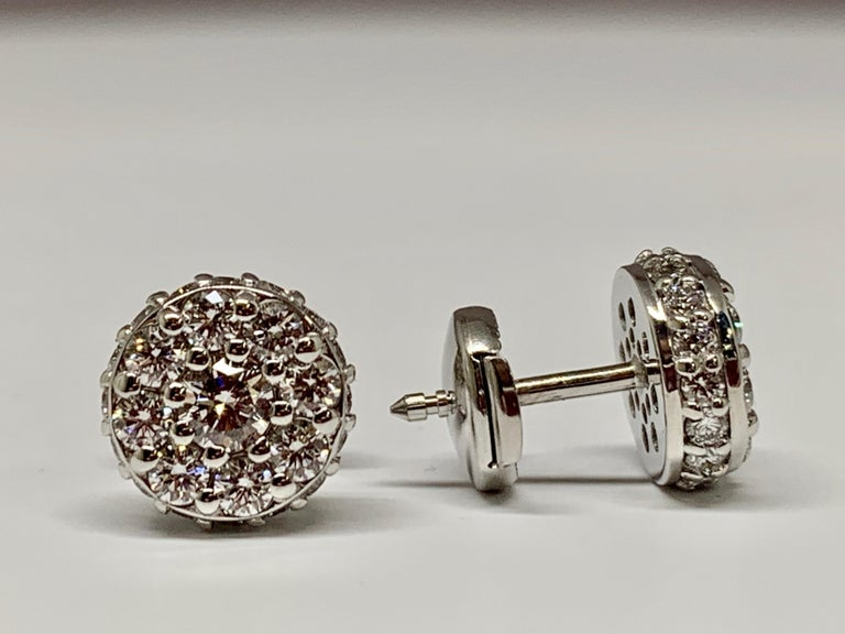 These gorgeous earrings are made of 18K white gold and include a total diamond weight of 1.48 carats. These studs are made up of round diamonds that are SI1 in clarity and G-H in color. These earrings include locking push backs for ultimate security