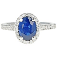 White Gold 1.58 Carat Oval Cut Sapphire and Diamond Halo Ring