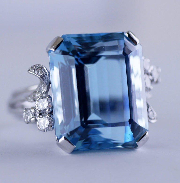 """Vintage ring with a lively Aquamarine of the finest """"Santa Maria"""" colour, handmade in England, circa 1940.  Central natural Aquamarine, emerald cut, weighing 21.73ct (carat). Approximate width of stone 15mm.   The Aquamarine set in 18ct white gold"""