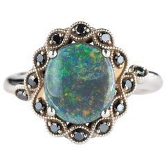 White Gold 2.30 Carat Oval Black Opal Halo Ring with Round Black Diamond Accents