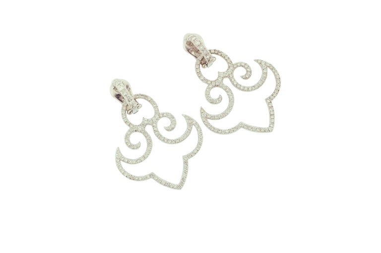 Very light 18 karat white gold earrings weighing 15.47 grams set with 3.25 carats of white brilliant cut diamonds.  Length: 1 7/8 inches