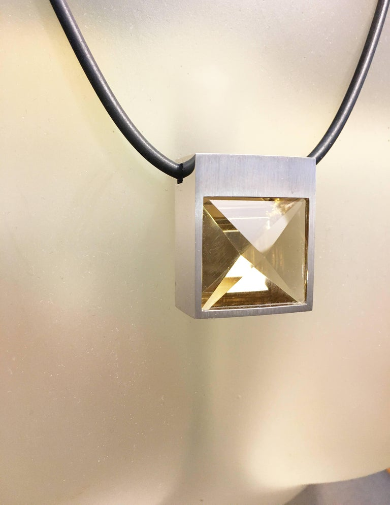 Be prepared to enter the fray in this one of a kind White Gold and Context Cut Citrine Square Pendant on Rubber Cord, because you're sure to incite envy from everyone else in the room. Set in 14k white gold the square Citrine weighs in at 38.29
