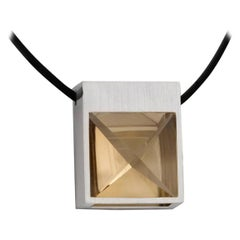White Gold and Context Cut Citrine Square Pendant on Rubber Cord